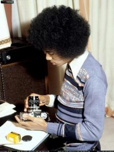 A young Michael Jackson with a camera